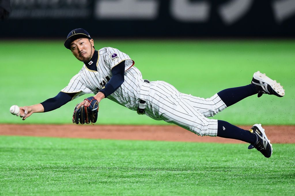 Infielder Ryosuke Kikuchi of Japan throws to the first