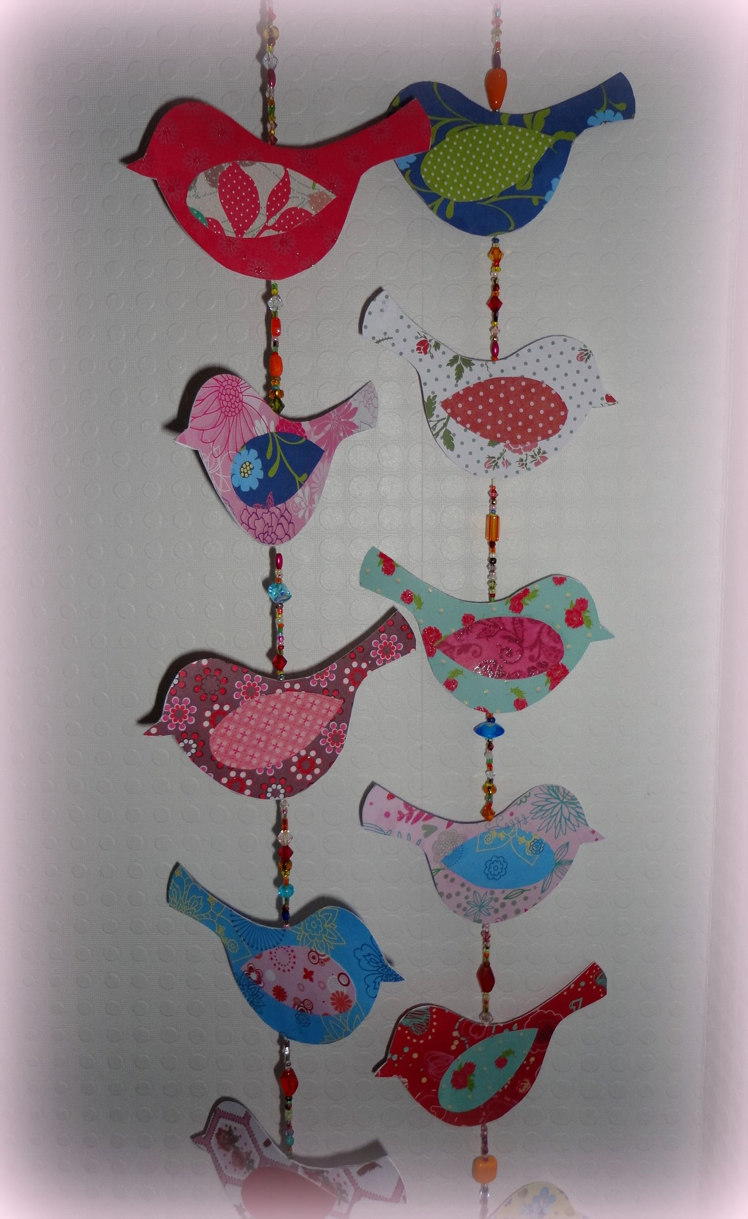This bird garland of paper is made with templates from