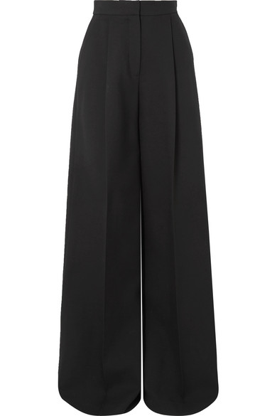 Alexander McQueen's first break in fashion was an apprenticeship on Savile Row - his affinity for clean lines and precise cuts still influence the label's designs today. Made in Italy, these pants are tailored from black crepe and fall to wide-legs long enough to slightly pool on the floor. Emphasize the flattering high rise and pleated front by tucking in your shirt.