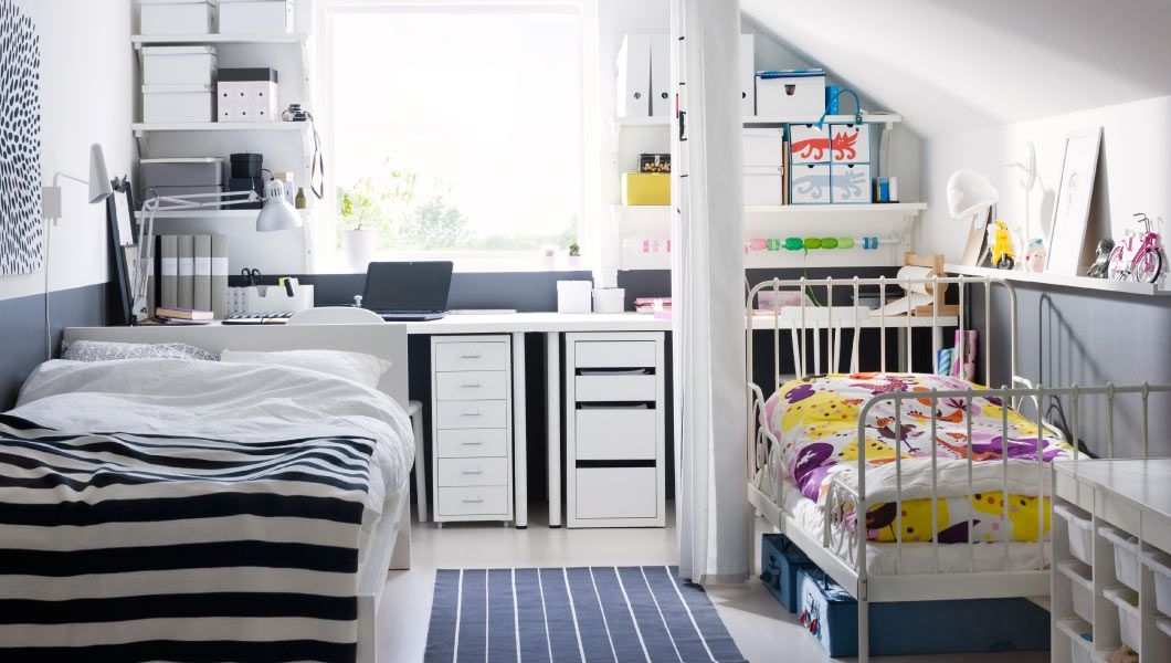 A Parent And Child Shared Bedroom And Workspaces With Curtain Divider