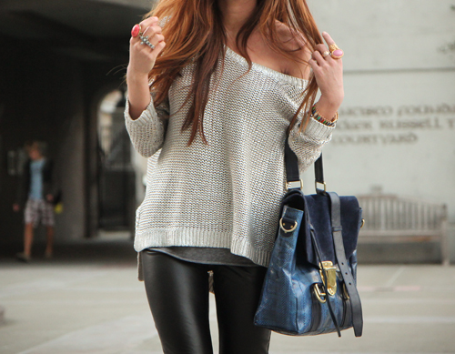 Coated black skinny jeans or faux leather pants, off the shoulder ...