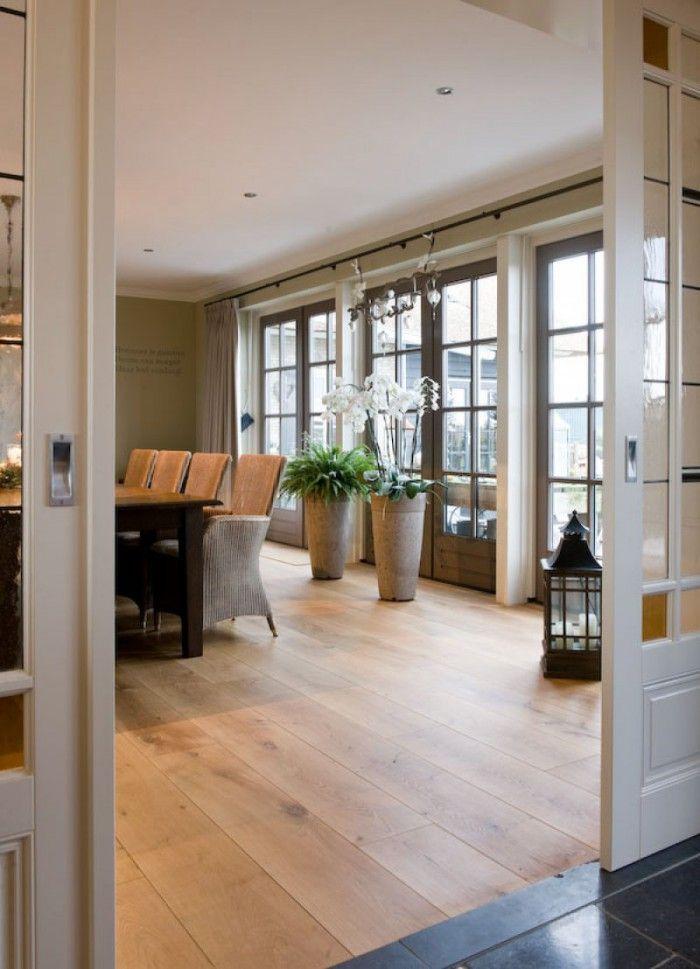 overgang hout naar nattursteen bij tussendeur - Salon / Salle à