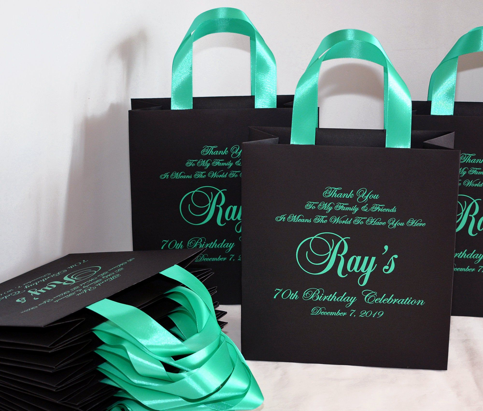 black gift bags with ribbon handles
