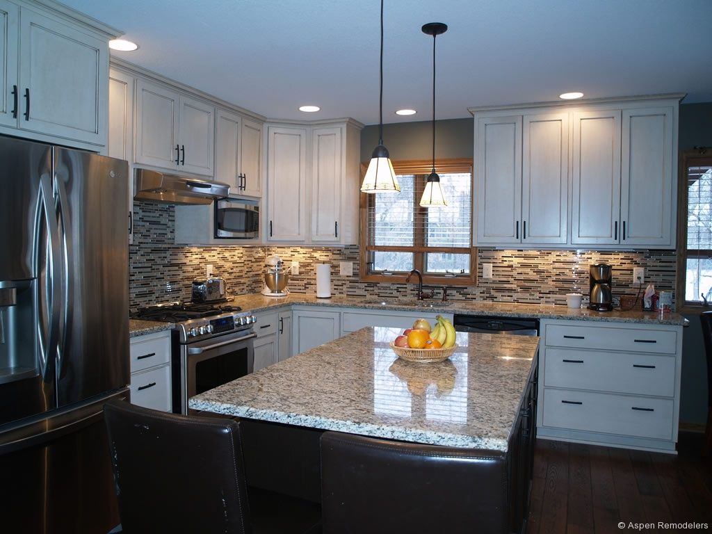 Custom white cabinet kitchen remodel aspen remodelers for Kitchen renovation images