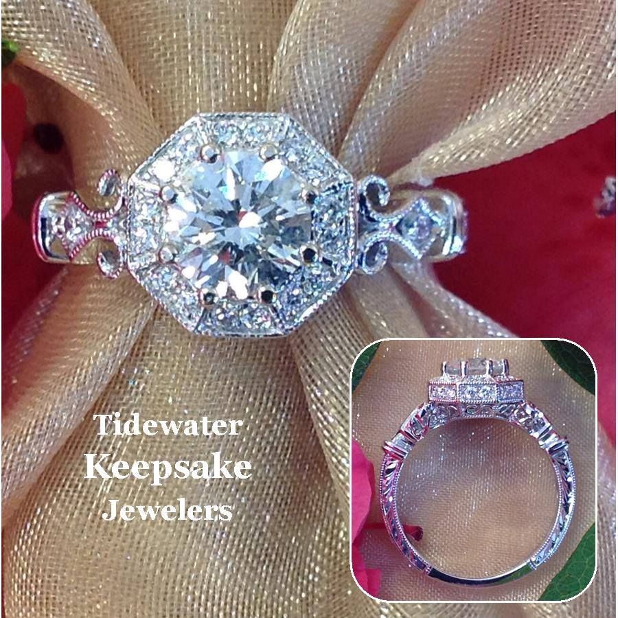 this lovely engagement ring features an octagon shaped halo and a