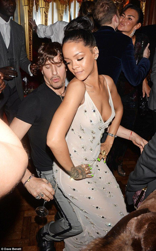 Transformation: Rihanna changed into a plunging semi-sheer gown as she let loose at a Brit...
