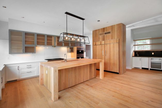 Desks · The Spacious Gourmet Kitchenu0027s Massive Wood Center Island Boasts A  Four Inch Maple Butcher Block
