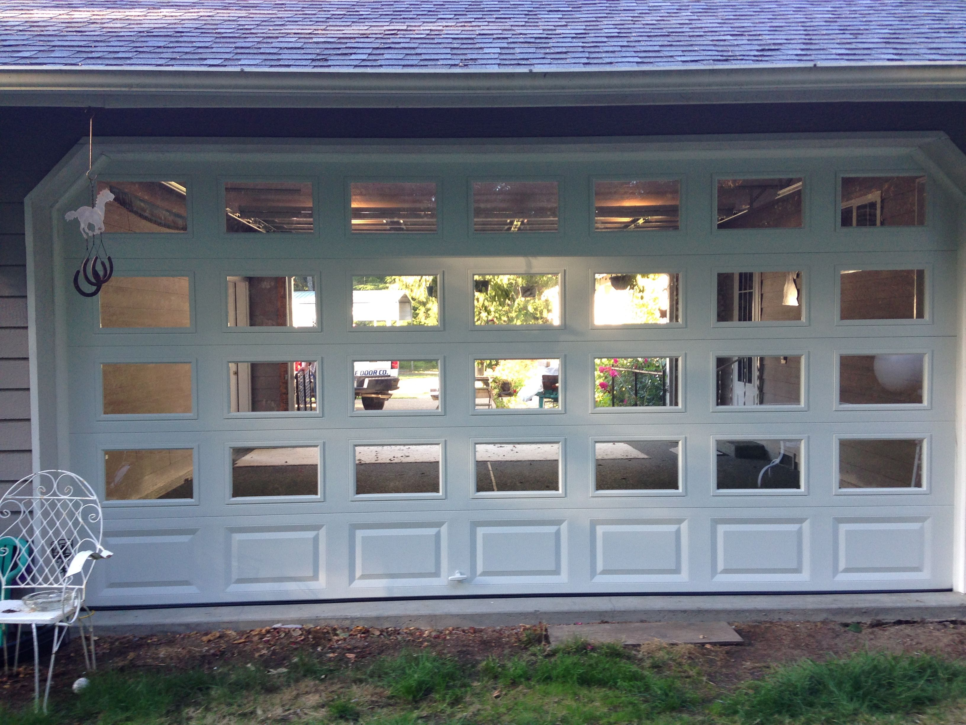 Need More Natural Light In Your Garage Consider Adding Glass Sections We Can Work With Any Budget To Get Garage Door Installation Garage Doors Outdoor Decor