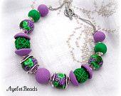 http://www.etsy.com/treasury/MTUxMjQzMzh8MjcyMjg0MDY4Ng/emerald-green-and-purple