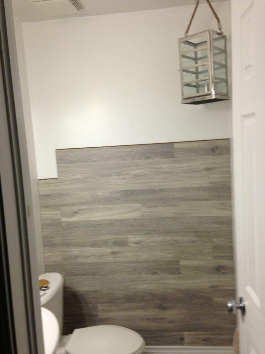 Bored to floored laminate floor accent wall diy - Laminate tiles for bathroom walls ...