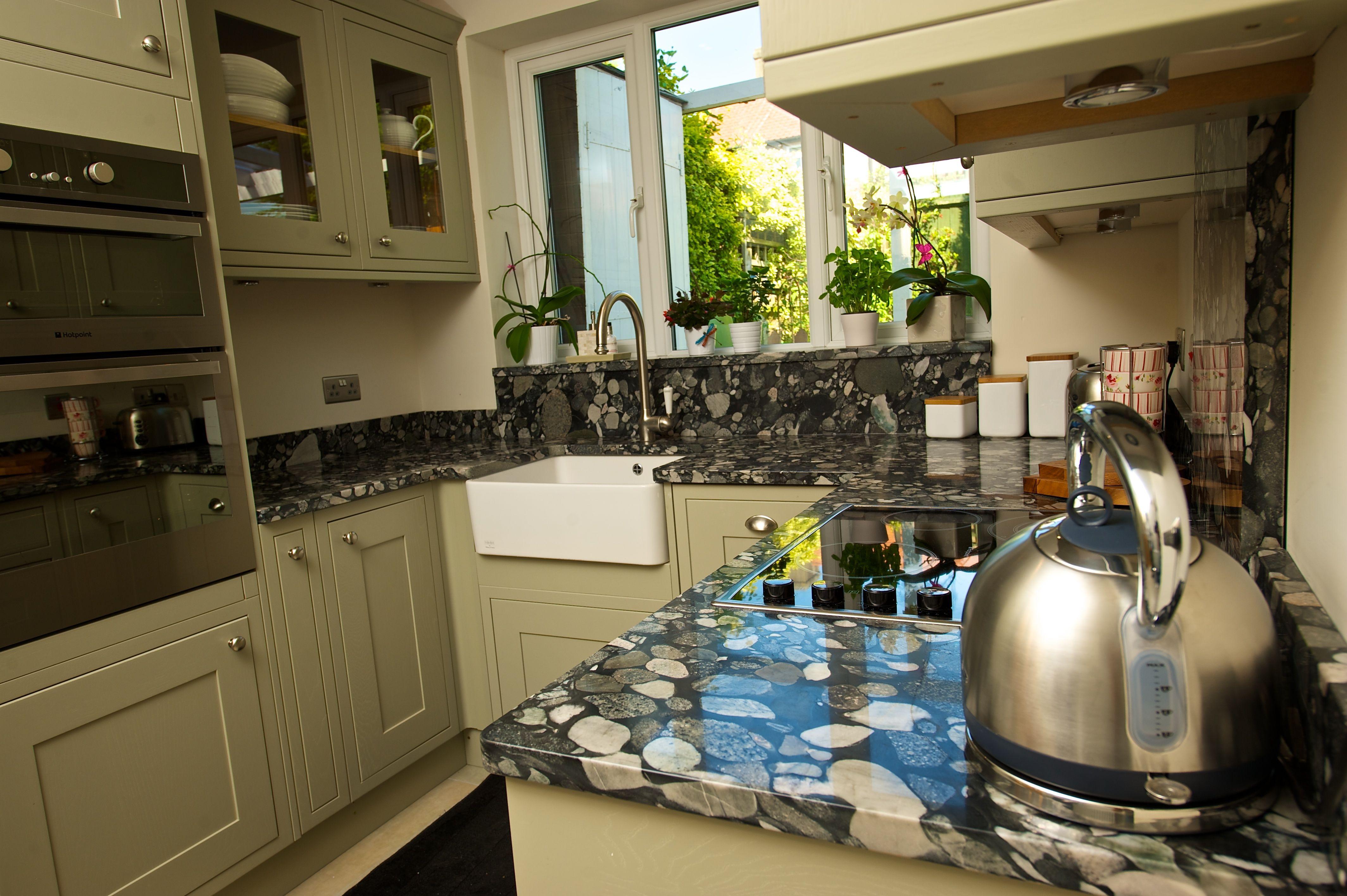 Black Marinace   White pebbles, Granite worktops, Kitchen