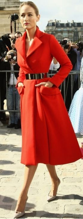 Elegant red coat and silver belt.