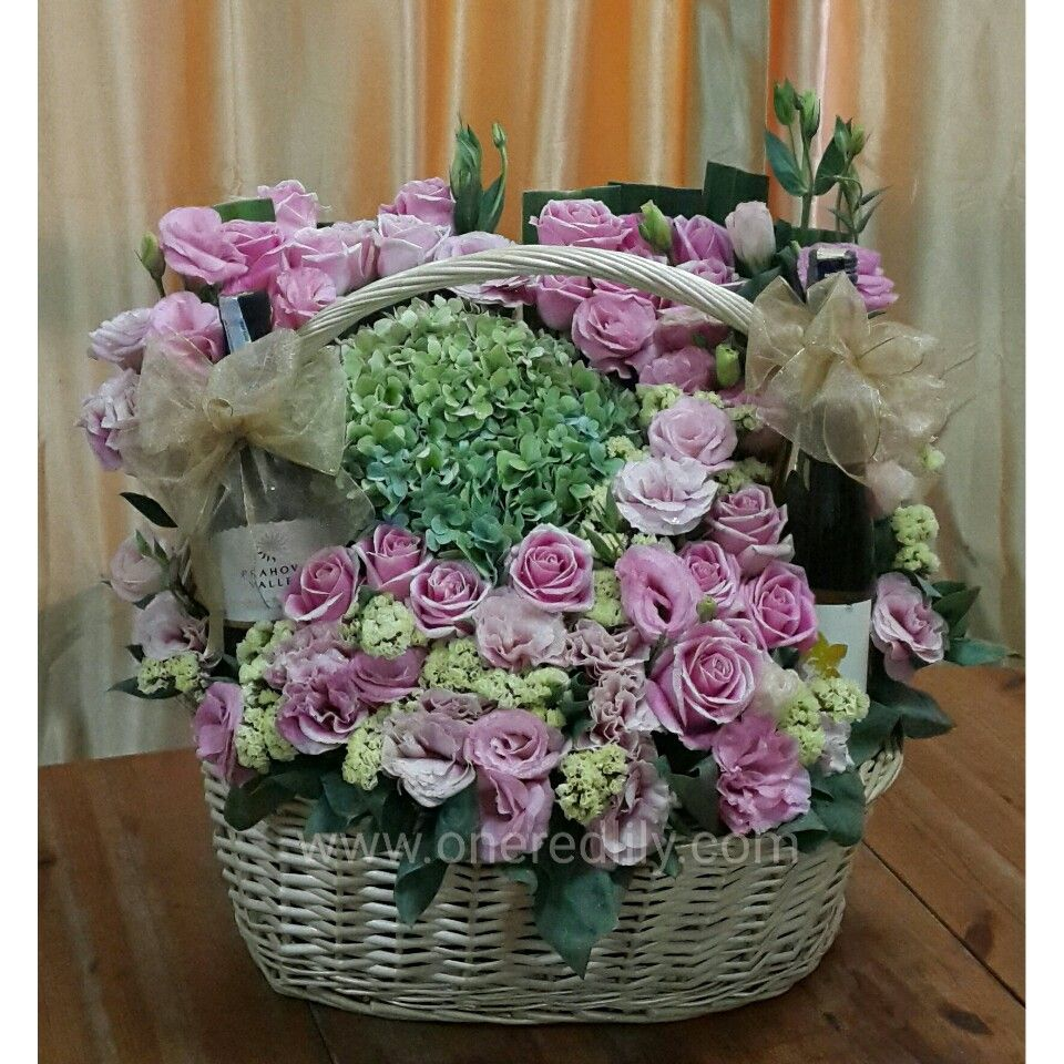 Flower basket with wines. Red lily flower, Flower