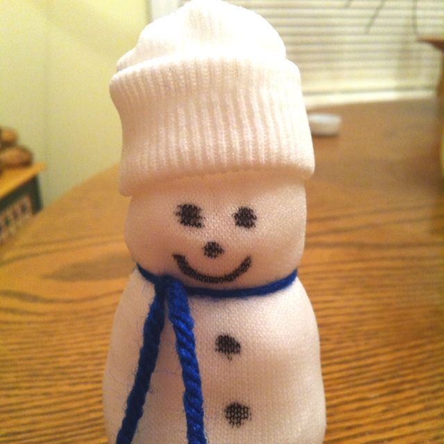 Snowman with stocking cap made out of a child's sick and cotton balls. Beans are placed in the bottom of the sock so frosty can stand up. :) cute idea for kids!