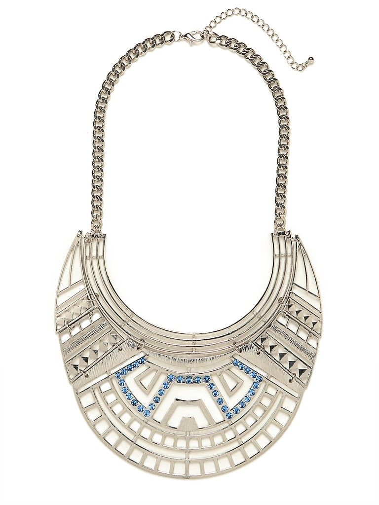 We love the way tribal influences collide with a futuristic vibe in this standout statement necklace. Just check out that audacious graphic pattern, in sleek silver and dotted with glam sky-blue gems.