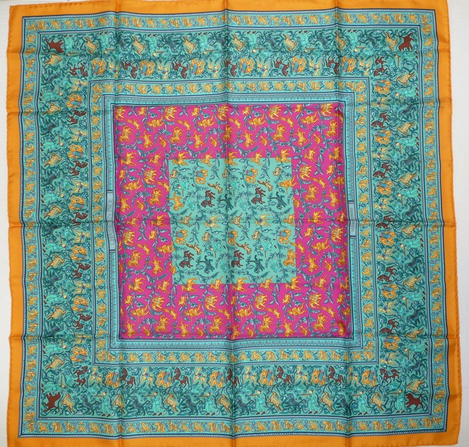 HERMES Paris Chasse En Inde Turquoise Pink Handrolled Silk Scarf 90 CM. Get the lowest price on HERMES Paris Chasse En Inde Turquoise Pink Handrolled Silk Scarf 90 CM and other fabulous designer clothing and accessories! Shop Tradesy now
