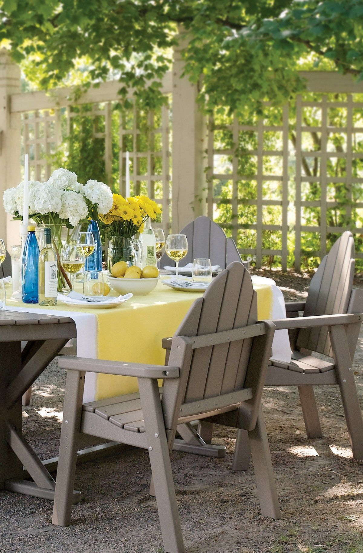 Fresh and fun outdoor summer tablescape in white blue and yellow love this
