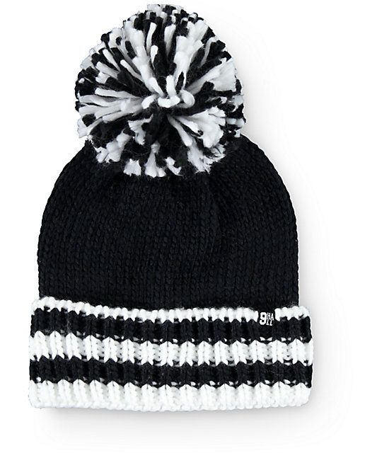 0ef526caf2ea0 Heat things up when the temperatures drop with this thick knit beanie that  features a foldover design with a contrast stripe cuff and a large size pom  at ...