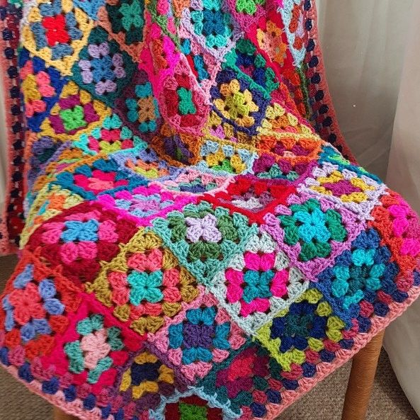 Newly completed Carousel granny squares blanket, each one is truly ...