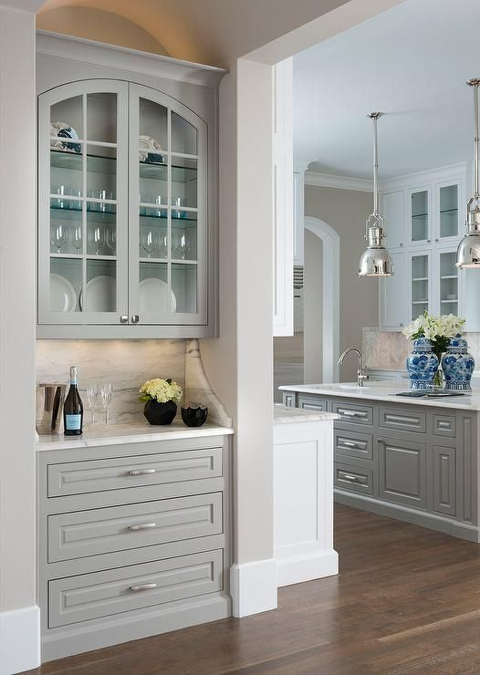 Beautiful Living Room Bar Nook Features Gray Raised Panel Cabinets Fitted With Polished Nickel Pulls
