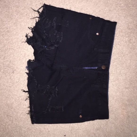Black ripped booty shorts New and has never been worn please inquire for any further details. Got them from Charlotte Russe Charlotte Russe Shorts Jean Shorts