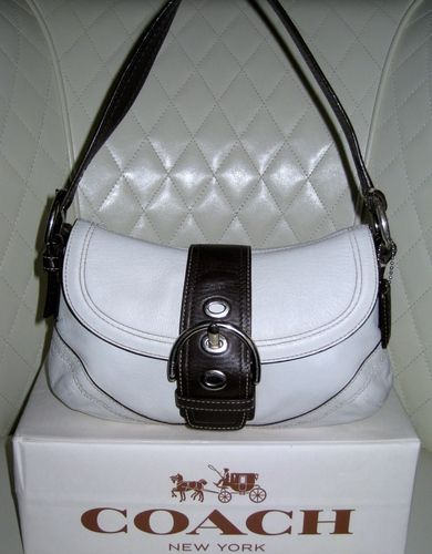 a6ea93883c1f  COACH Soho Leather White with Brown Trim Hobo Bag   is going up for  auction on Tophatter.