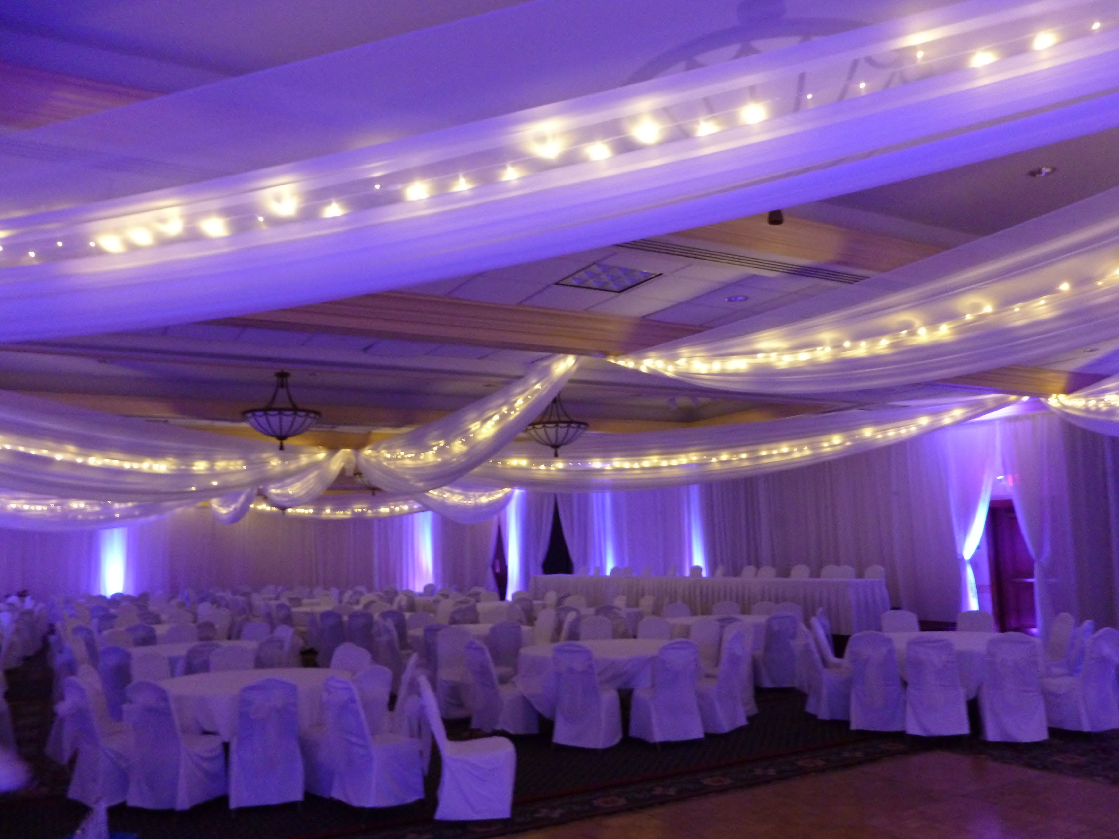 White Chair Covers with Navy Blue Organza Sashes flip tie at