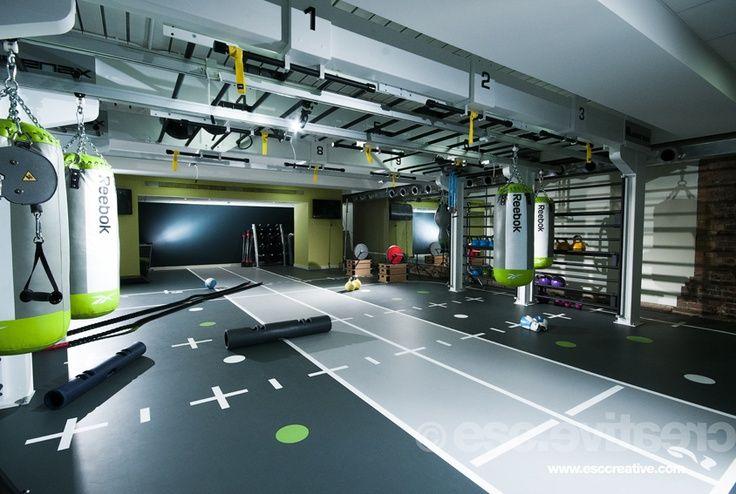 modern home gym basement space greenwich design ideas | modern fitness spaces - garage doors | Gym interior, Gym ...