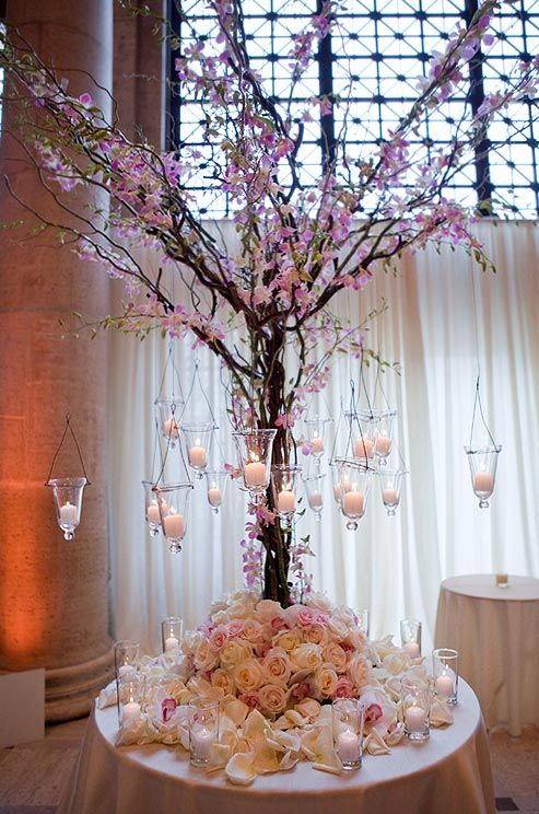 Altar Décor: a stunning tree wrapped with pink orchids surrounded with roses and candles.