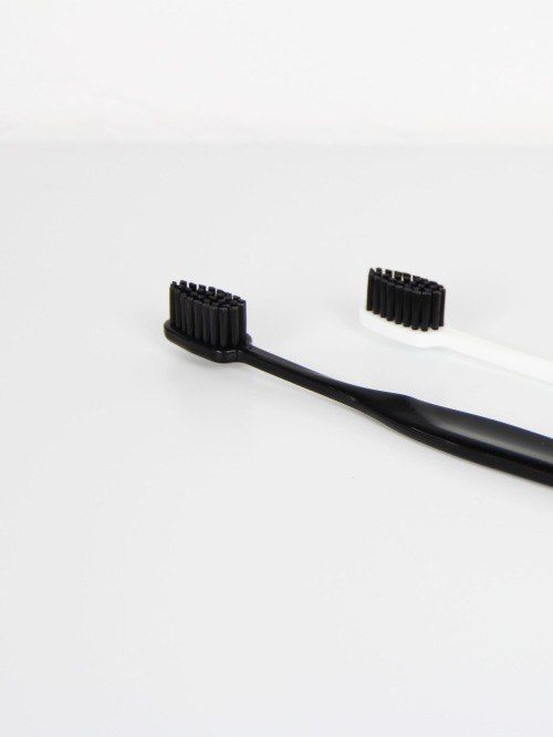 Black and white designed tooth brushes.