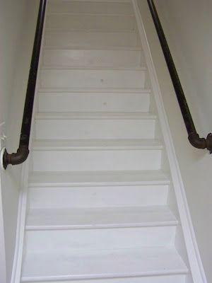 Plumbing pipes as stair rail.