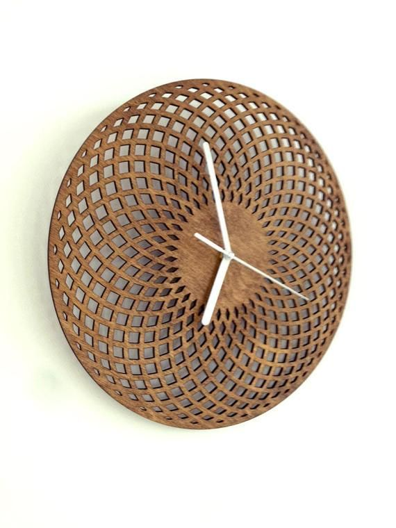 Handmade geometric wooden wall clock Realized using lasercut machine, painted with oak wood paint and fitted with a quartz mechanism It requires 1 x AA battery which is not included Size: 29 cm x 29 cm - 11.4 inch x 11.4 inch OVERSEAS TRANSACTIONS: please note that, to avoid any