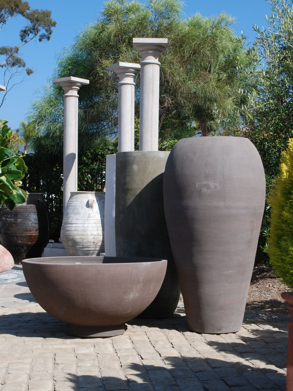 Our Terrecotte San Rocco line of pottery has the perfect shapes for mid-century modern designs. Simple and elegant for your home and garden.