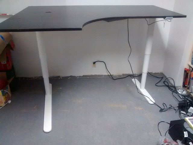 I bought a used GALANT corner desk tabletop and hacked it with the