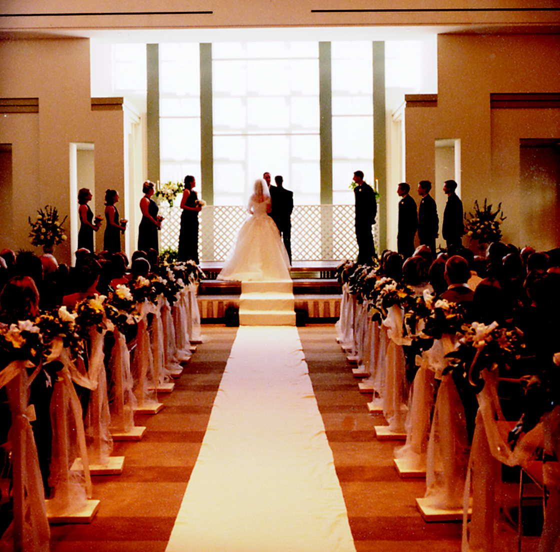 A Wedding Ceremony Held In Front Of Window Salon 1 Our Ballroom