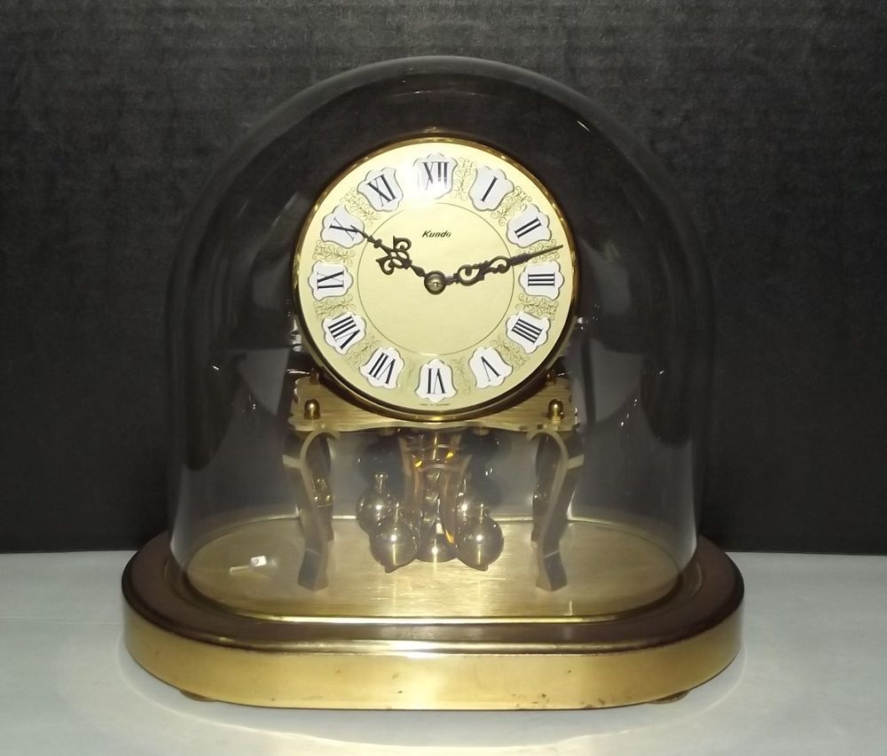 vintage kundo 400 day anniversary clock with oval glass dome germany