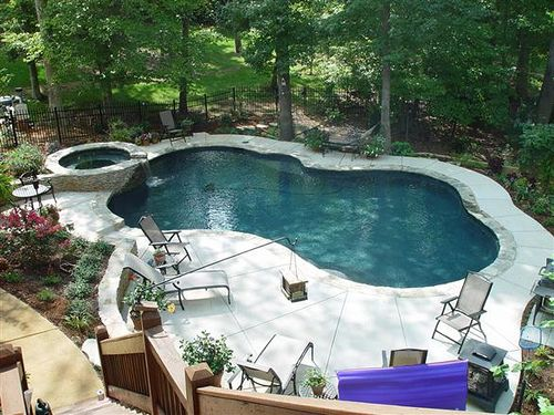 Pool Into Steep Slope Pools Backyard Inground Pool Landscape Design Backyard Pool Landscaping