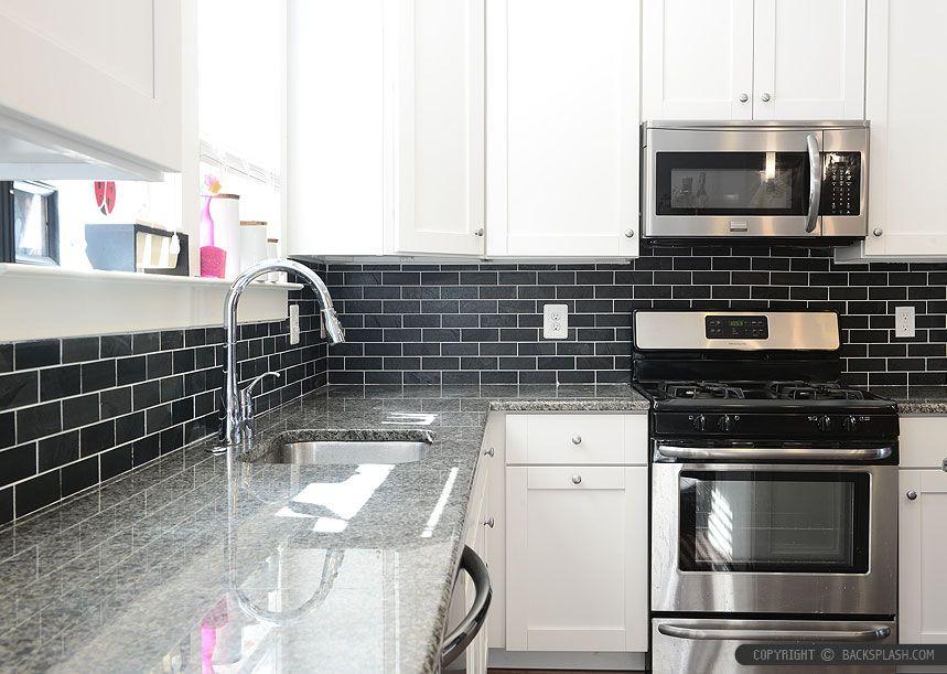 White cabinet new caledonia granite black slate backsplash for Kitchen slate floor white cabinets