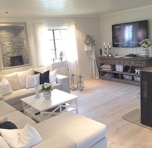 White Sofa + Natural Wood Floors + Rustic Accent Furniture · Living Room ...