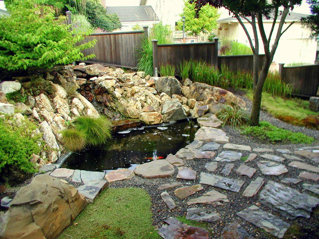 Stone Koi Pond With Waterfall Pond Design Koi Pond Design Landscaping With Rocks