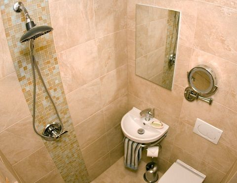 Simple Ways To Add A Half Bathroom And What To Consider Before You Start Wet Rooms Half Wall Shower Shower Wall Tile