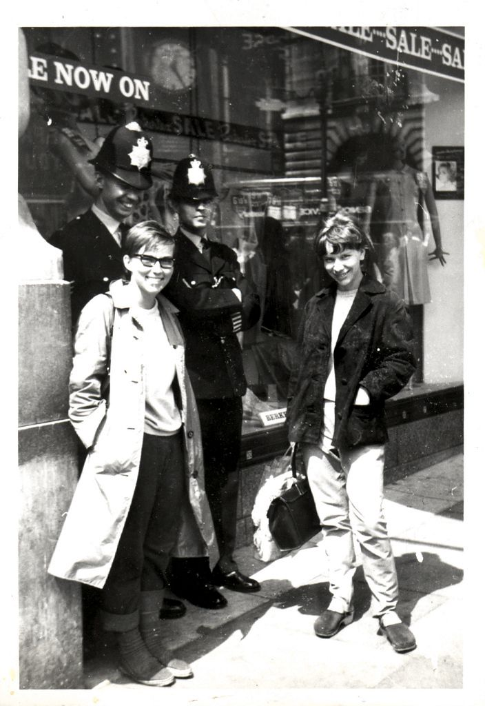 Pirjo and Riitta with two London Bobbies. 1965.