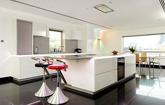 Spectacular Alno Star Highline High Gloss White Kitchen with Miele Appliances and Corian Worktops