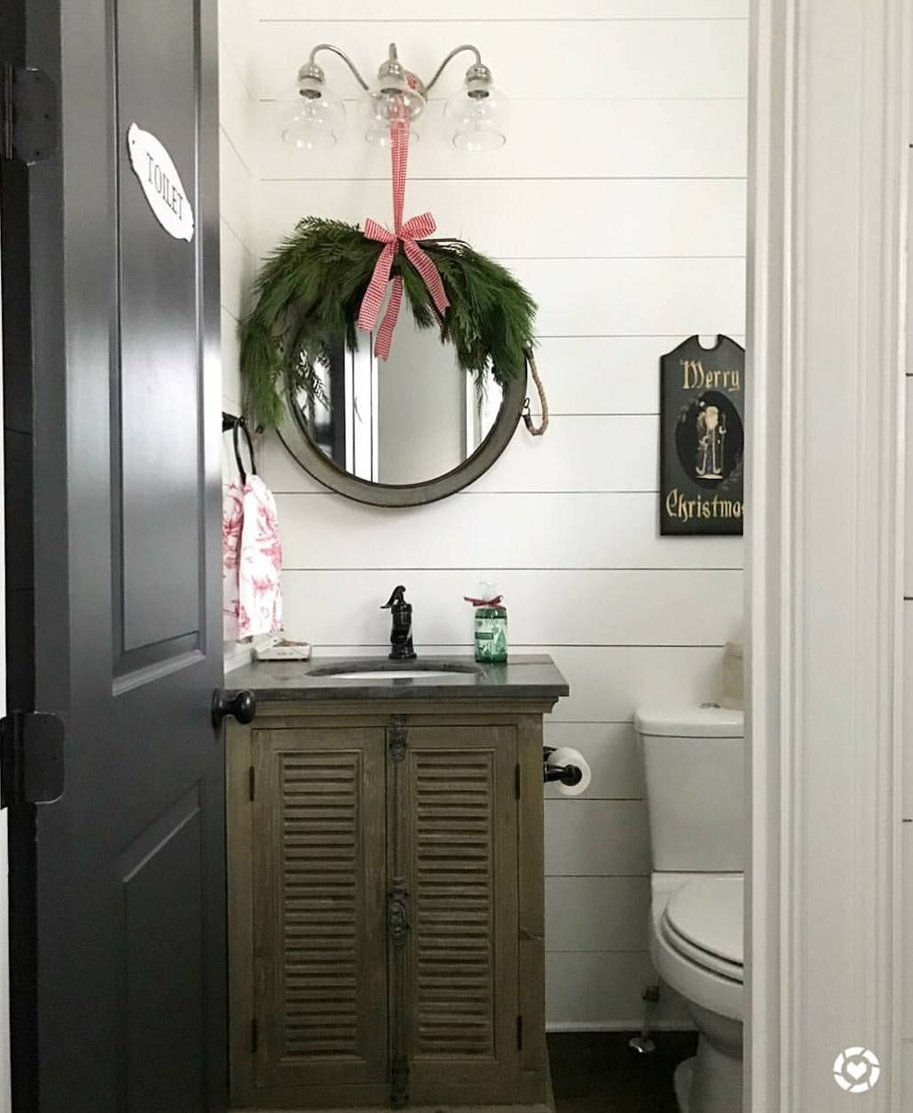 Greenery and ribbon over a powder bath mirror | Christmas Decor ...