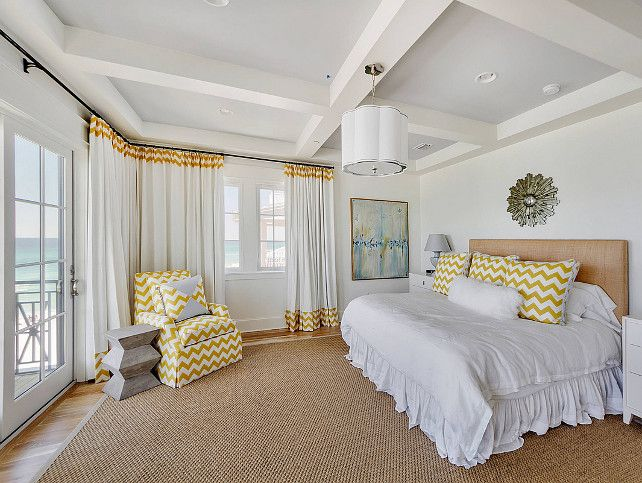 Bedroom Decorating Ideas. Bedroom with white bedding and chevron pillows, draperies and chair. #Bedroom #BedroomDecor  #Chevron #Fabrics Geoff Chick & Associates.