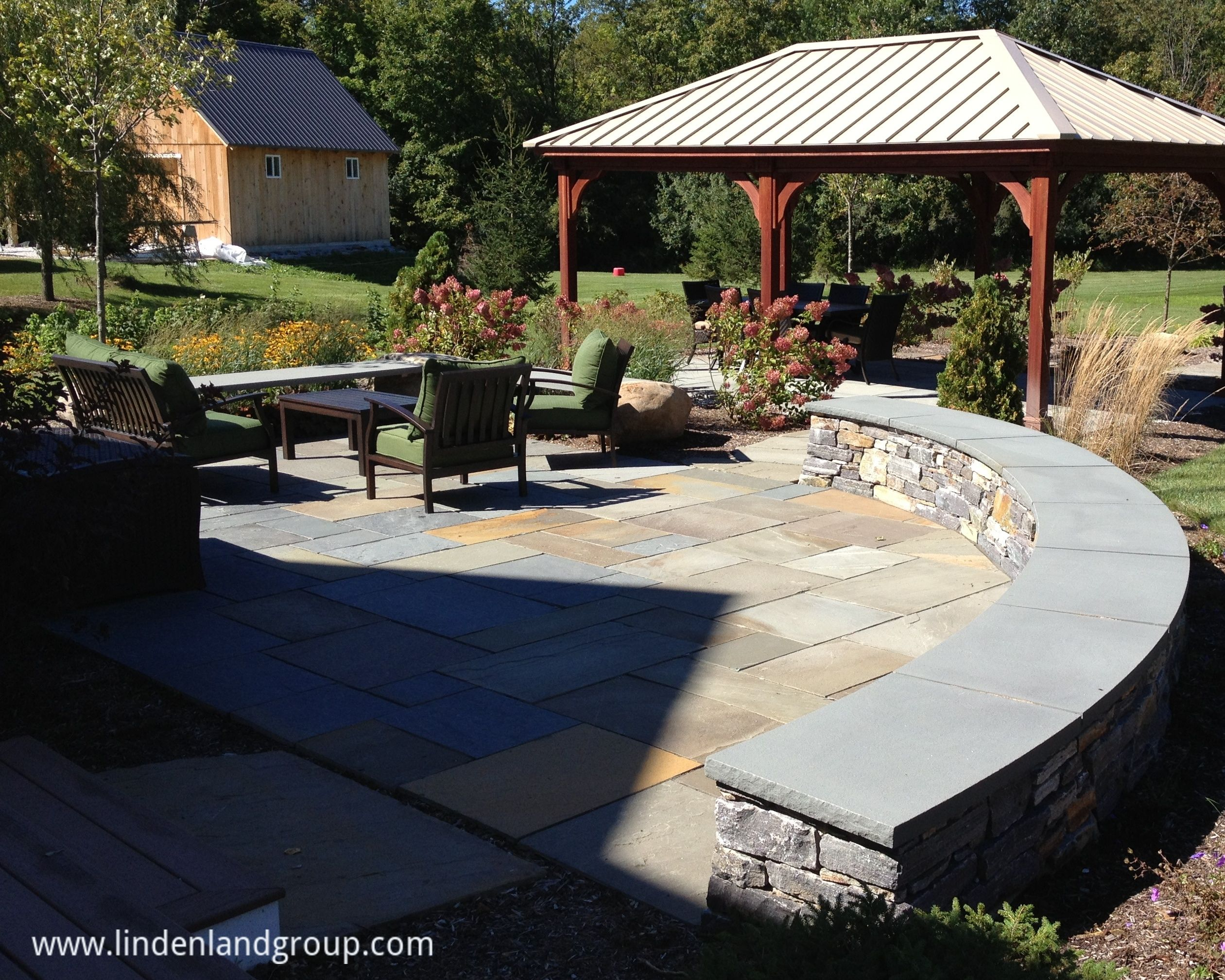 This radius curved sitting wall made from American Granite and a