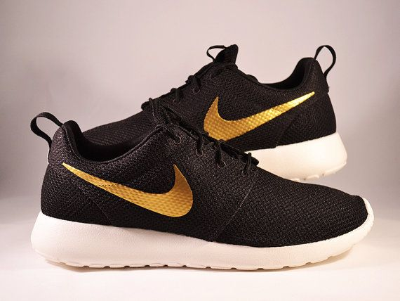 nike roshe with gold swoosh