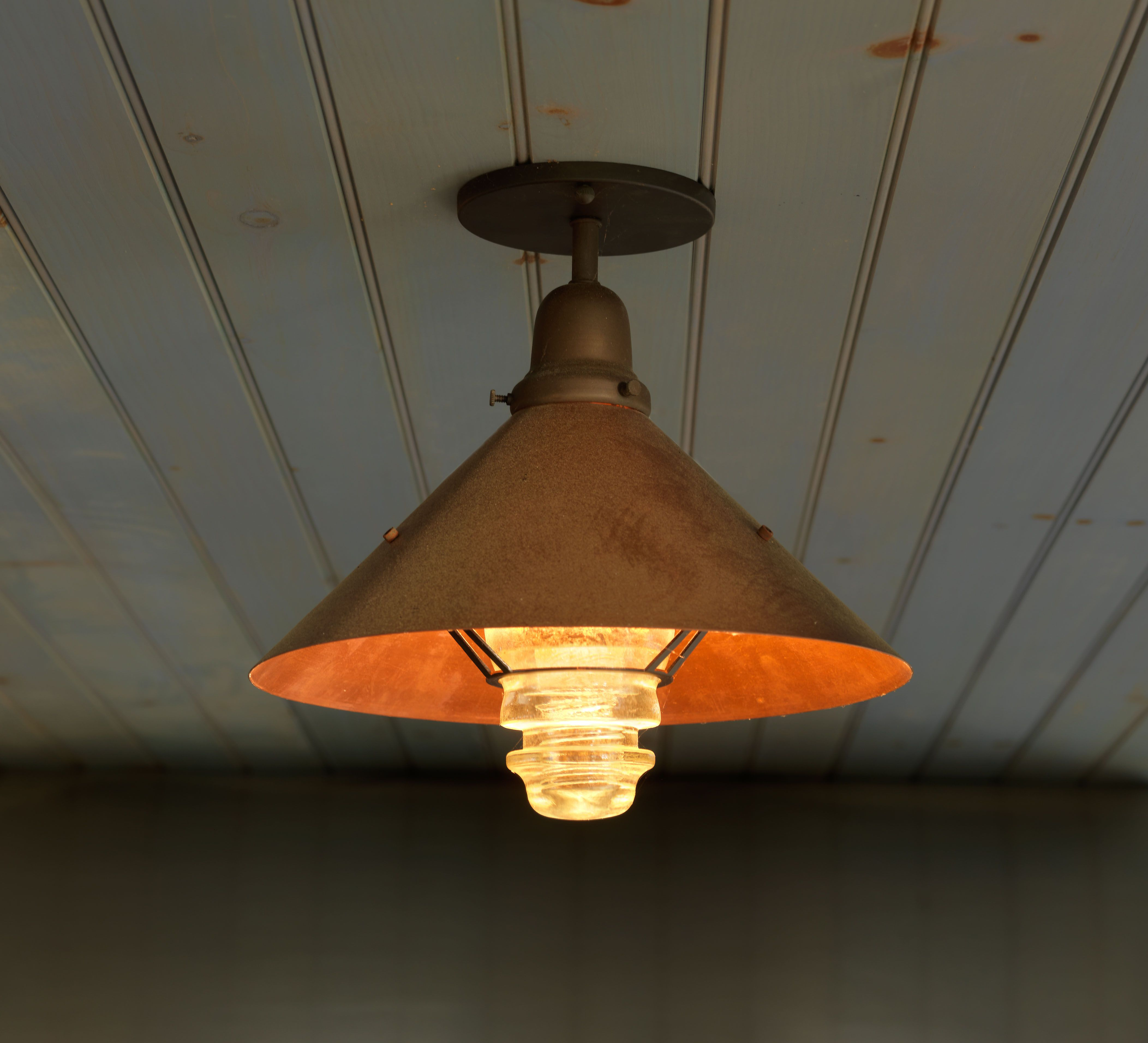 copper shade with vintage glass insulator to diffuse the light