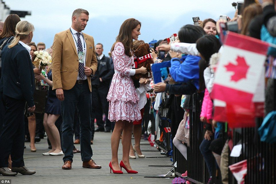 The Duchess of Cambridge speaks to some of the hundreds of people who waited for hours to see the Royal visitors