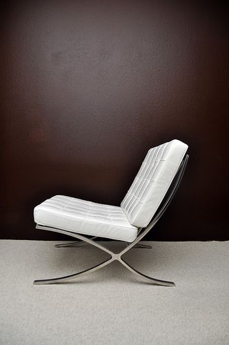 A White Barcelona Chair Barcelona Chair Chair Design Ludwig Mies Van Der Rohe
